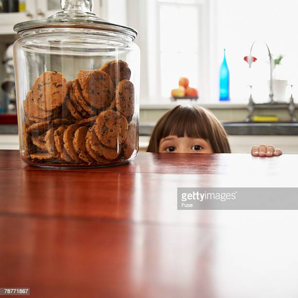 Girl Peeking Over the Counter