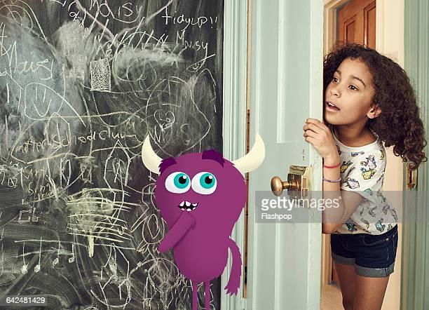Girl peering around door looking for monster