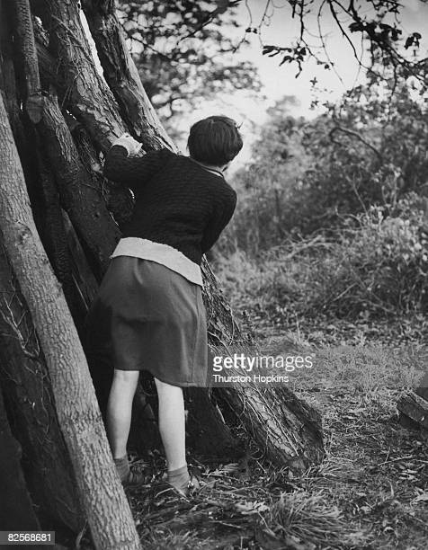 A girl peers down the 'Nun's Walk' at Borley Rectory in Essex 1st January 1955 Since 1900 several people claim to have seen the ghost of a nun on...