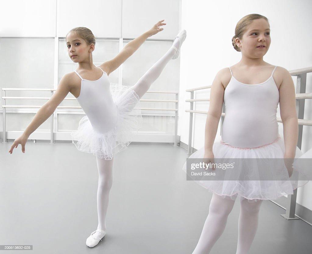 Girl (8-10) performing arabesque in ballet class, portrait : Stock Photo