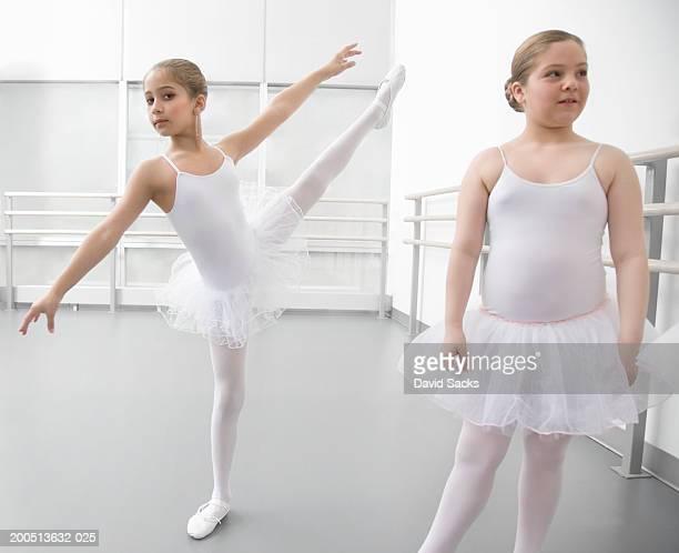 girl (8-10) performing arabesque in ballet class, portrait - アラベスクポジション ストックフォトと画像