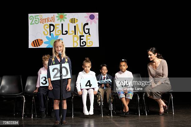 Girl (6-7) performing at spelling bee competition