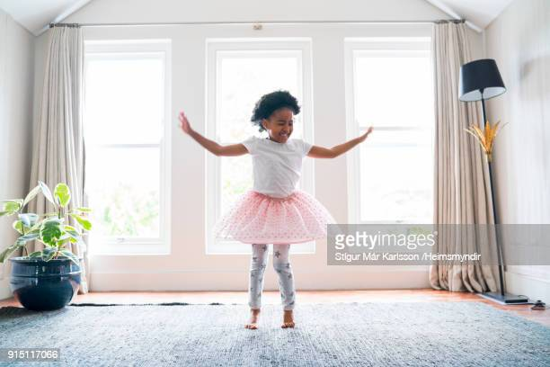 girl performing ballet dance at home - ballet dancer stock pictures, royalty-free photos & images