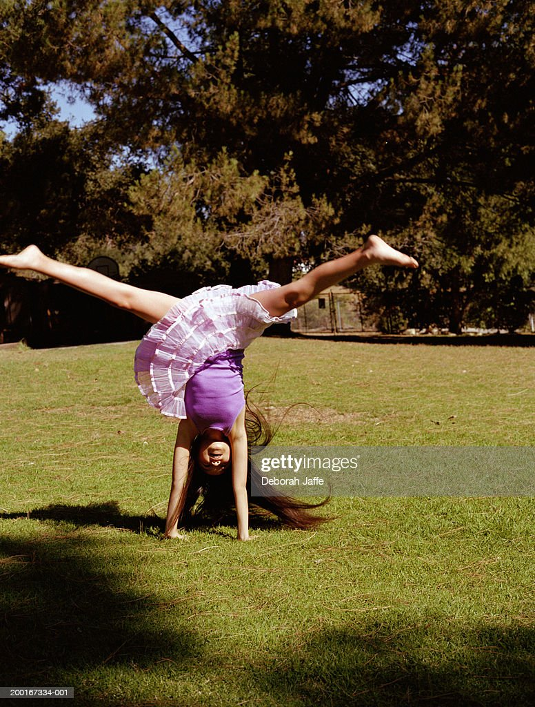 Girl Performing Handstand Outdoors Stock Photo  Getty Images-1321