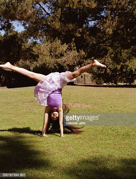 girl (9-11) performing handstand outdoors - little girls up skirt fotografías e imágenes de stock