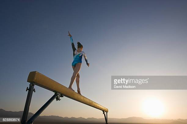 girl performing on balancing beam in the desert - balance beam stock pictures, royalty-free photos & images
