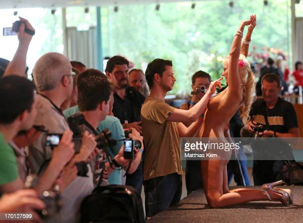 A girl performs during the first women's naked soccer European Championship at 'Palais am Funkturm' on June 7 2013 in Berlin Germany