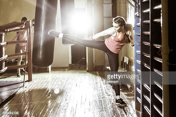 Girl Performs Kickboxing Exercises