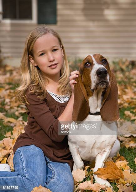 Girl petting dog outdoors