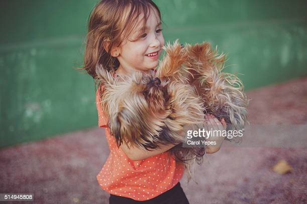 girl PETTING DOG