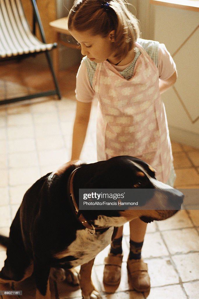Girl petting dog : Stock Photo