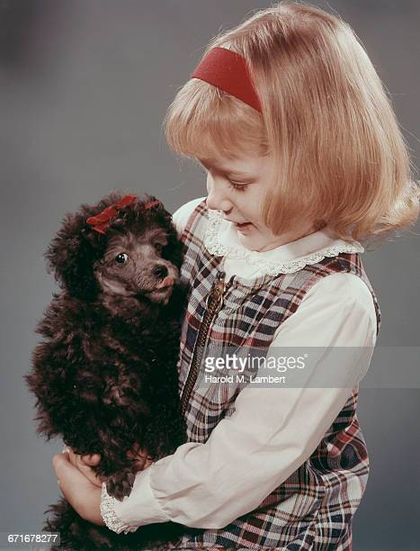girl petting her puppy  - pawed mammal stock pictures, royalty-free photos & images