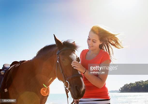 girl petting horse outdoors - girl blowing horse - fotografias e filmes do acervo