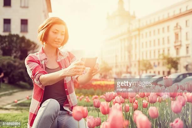 Girl photographing a garden