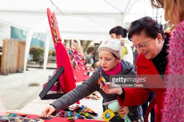 """girl picking """"little march"""" talisman - martisor stock-fotos und bilder"""
