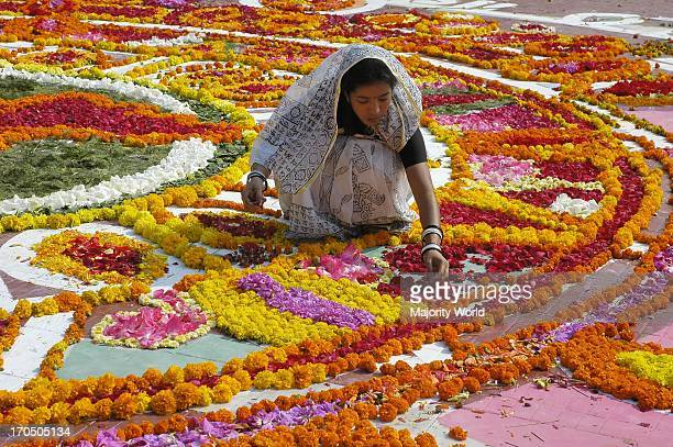 A girl places flowers as a decoration at Central Shahid Minar in Dhaka the monument for the martyrs of the 1952 language movement on International...