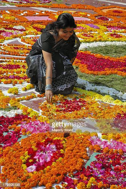 A girl places flowers at the Central Shahid Minar in Dhaka the monument for the martyrs of the 1952 language movement on International Mother...