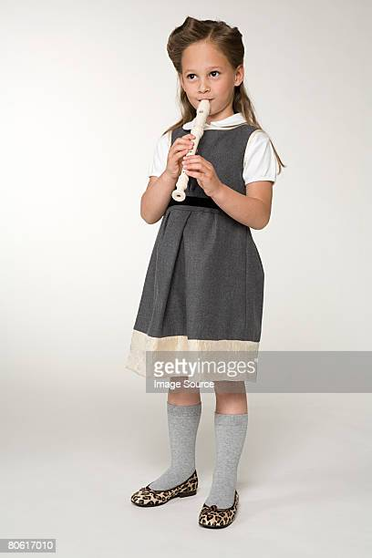 a girl playing a recorder - recorder musical instrument stock photos and pictures