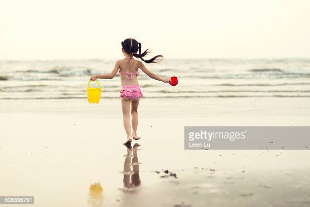 Girl playing and walking on beach