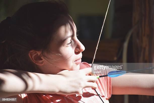 Girl playing archery