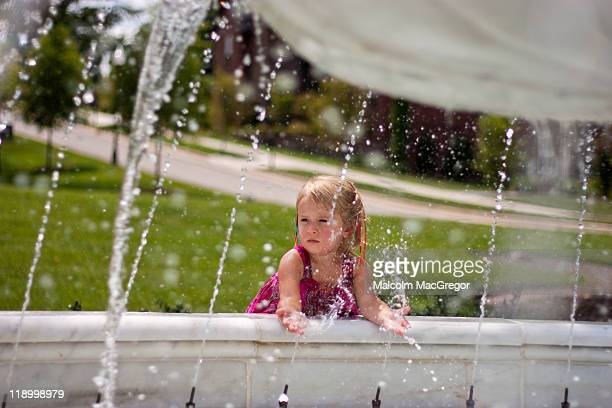 Girl playing at Fountain