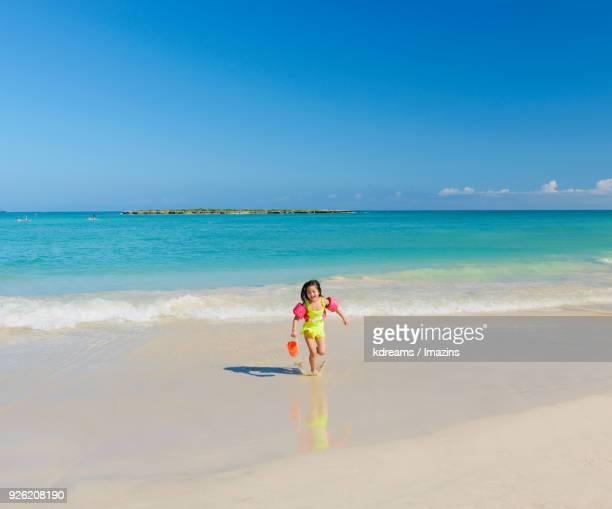 girl playing at kailua beach, hawaii - kailua beach stock photos and pictures