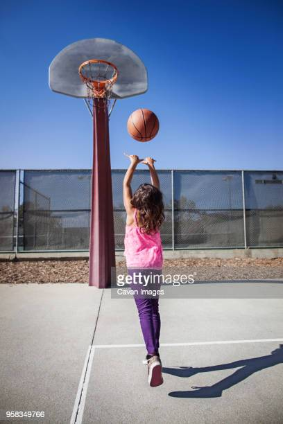 girl playing basketball on court - shooting baskets stock pictures, royalty-free photos & images