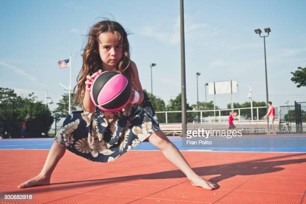 a girl playing basketball. - dribbling sports stock pictures, royalty-free photos & images