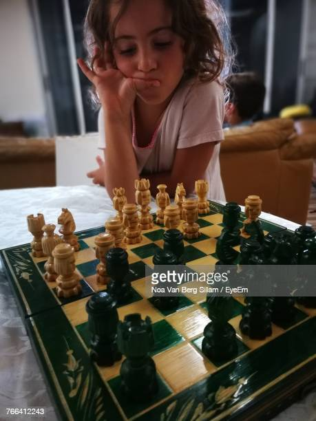 girl playing chess at home - reality kings stock pictures, royalty-free photos & images