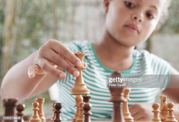 girl playing chess - chess stock pictures, royalty-free photos & images