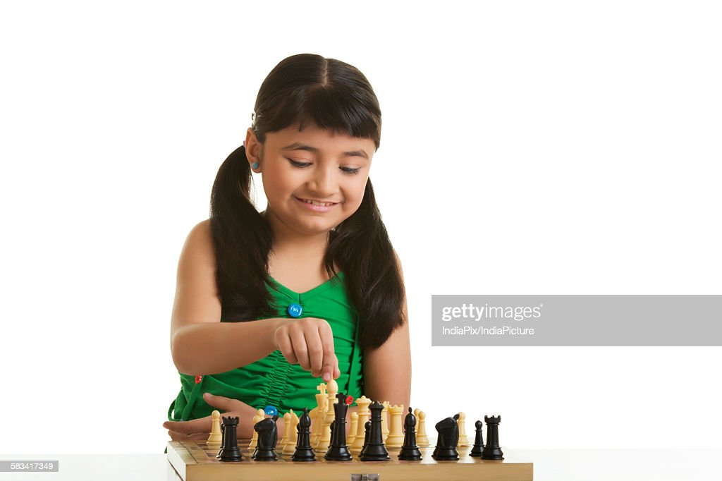 Girl playing chess : Stock Photo