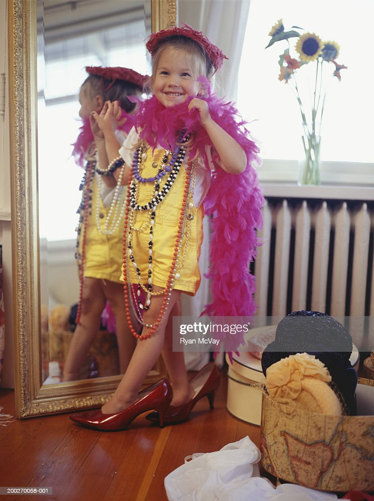 Girl Playing Dress Up In Bedroom Stock Photo Getty Images