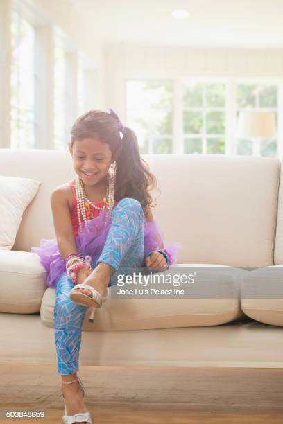 girl playing dress up in living room - little girl in high heels stock photos and pictures