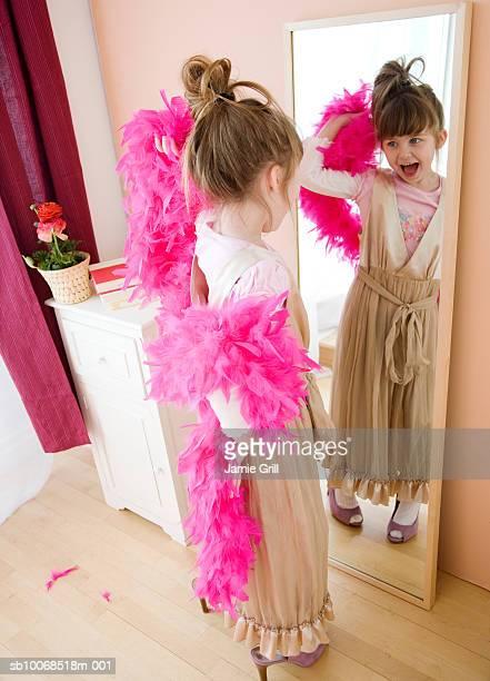 Girl (6-7) playing dress up