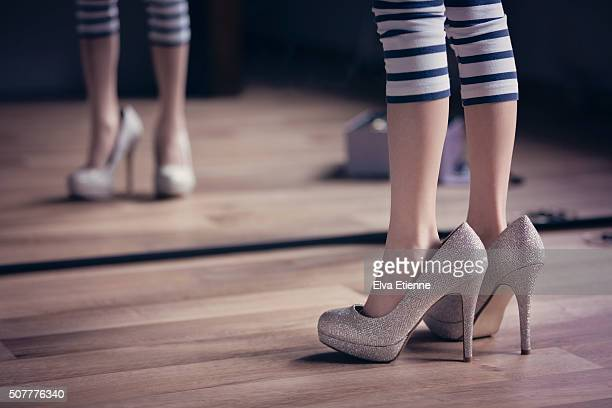 Girl playing dress-up in high heel shoes