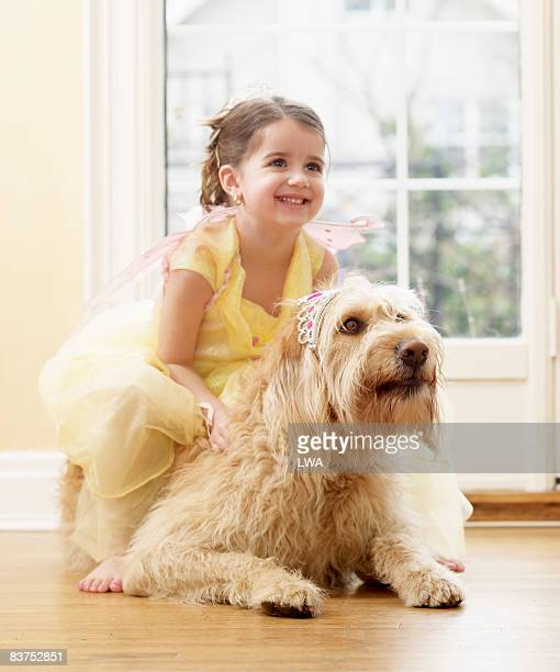 Girl Playing Dressup with Labradoodle