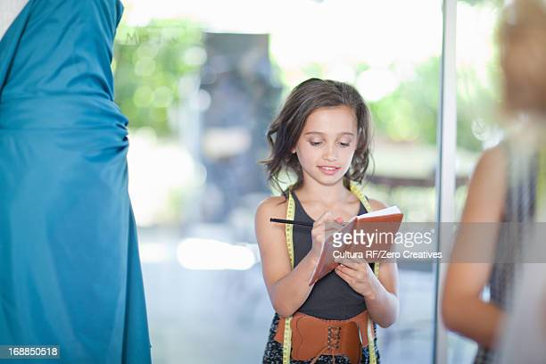 girl playing fashion designer - adult imitation stock pictures, royalty-free photos & images