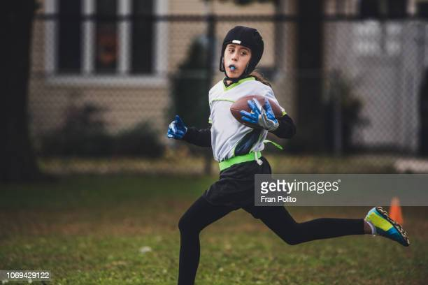 A girl playing flag football.
