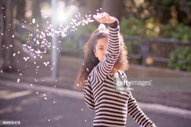 Girl playing flower petal