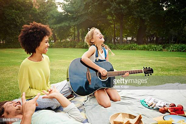 girl (8 - 9 years) playing guitar at picnic - 25 29 years stock pictures, royalty-free photos & images