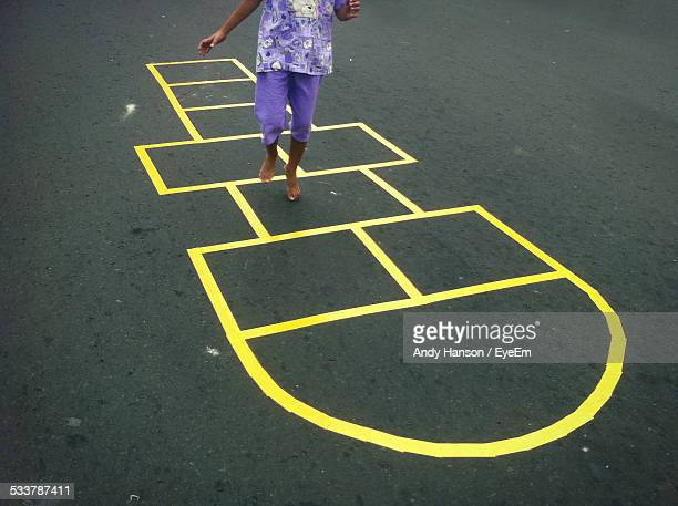 girl playing hop scotch - hopscotch stock pictures, royalty-free photos & images