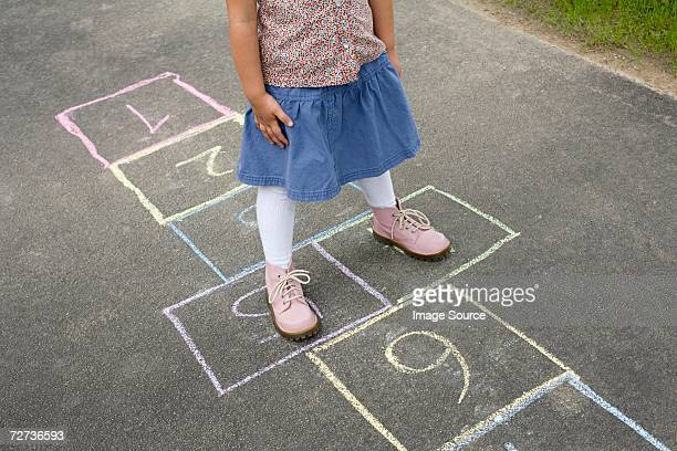 girl playing hopscotch - hopscotch stock photos and pictures