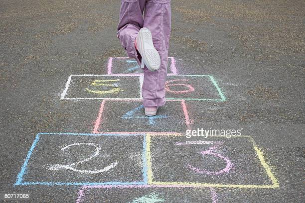 girl playing hopscotch - hopscotch stock pictures, royalty-free photos & images