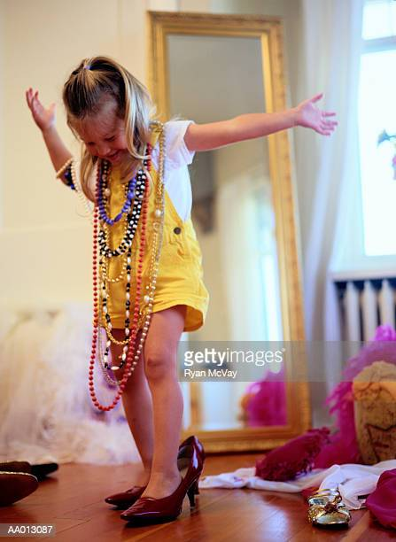 girl playing in dress-up clothes - little girl in high heels stock photos and pictures
