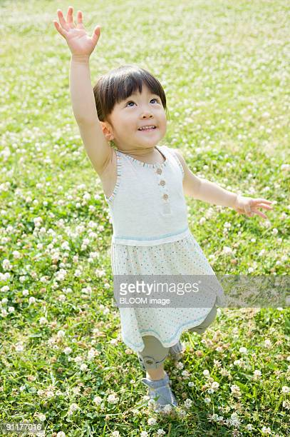 Girl playing in field