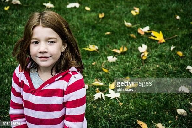 girl (7yrs) playing in grass