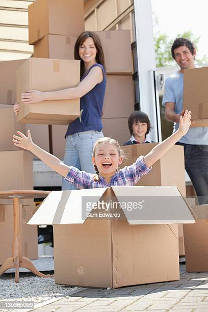 Girl playing in moving box