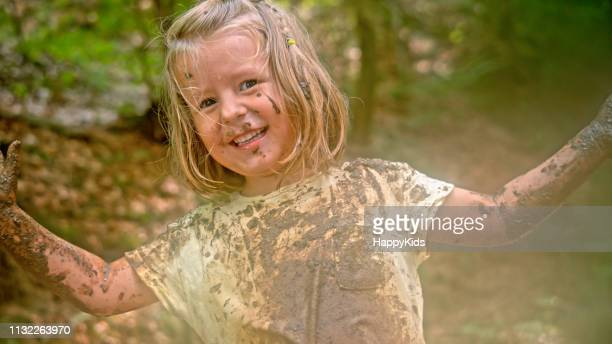 girl playing in mud - wet t shirt girls stock photos and pictures