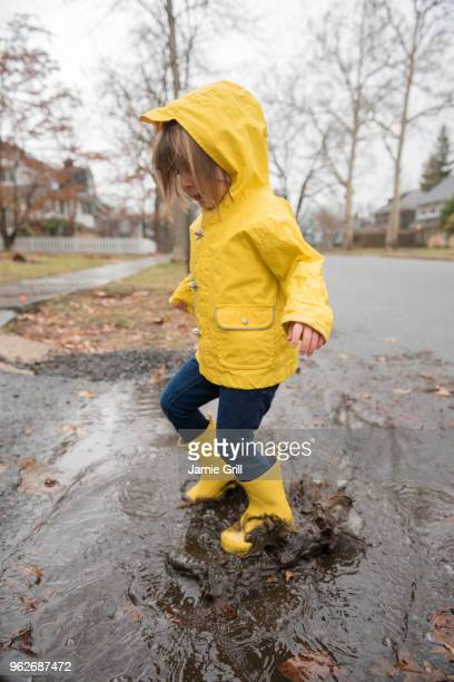girl (2-3) playing in puddle - montclair stock pictures, royalty-free photos & images