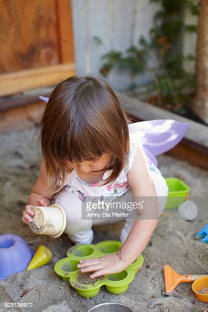 Girl (2-3) playing in sandbox